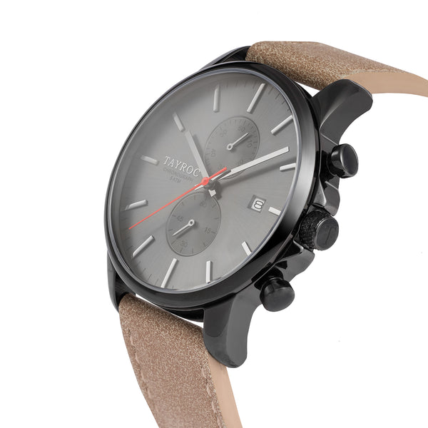 TXM093 from the Iconic Collection. A watch with black face and case, brought together with a leather strap. Side view.