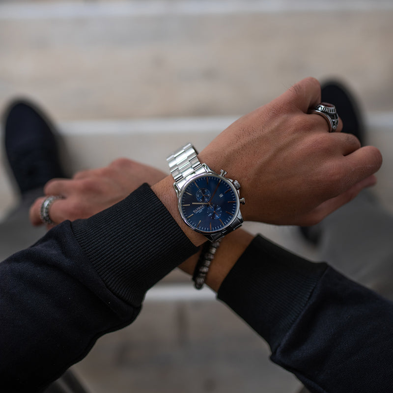 TXM119, a striking blue dial set into a silver case with silver two-tone bracelet. Model Shot 2.