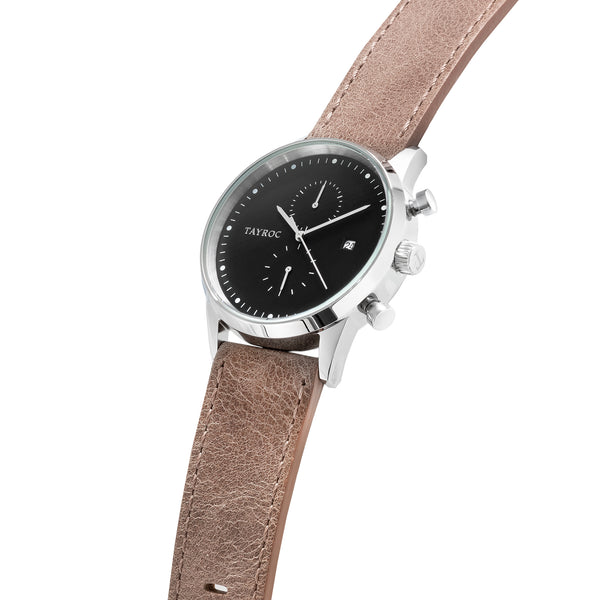 Bringing together the smooth brown leather strap with silver case and dark face a design to be reckoned with. Side view.