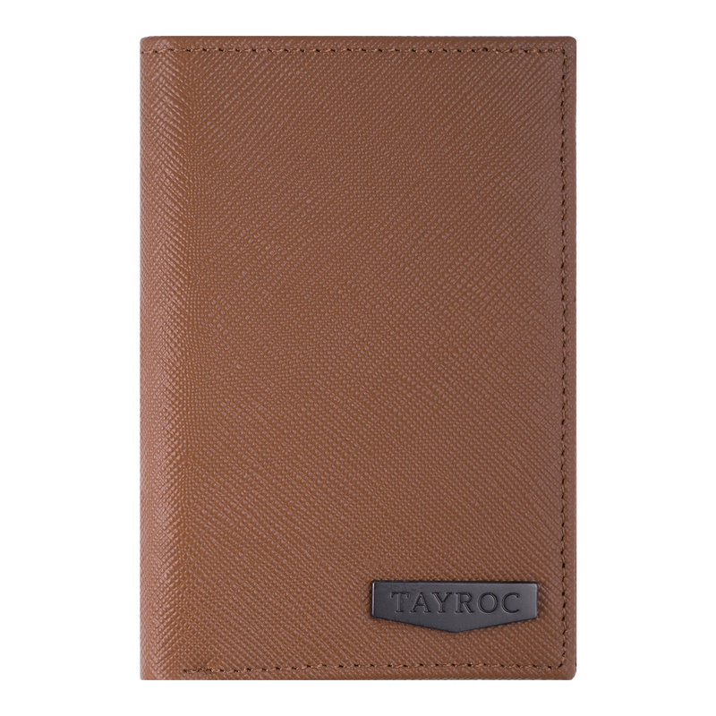 Trent by Tayroc. A tan leather bifold wallet, featuring edge stitching and embossed Tayroc logo on a steel tag in a slender design. Front View.