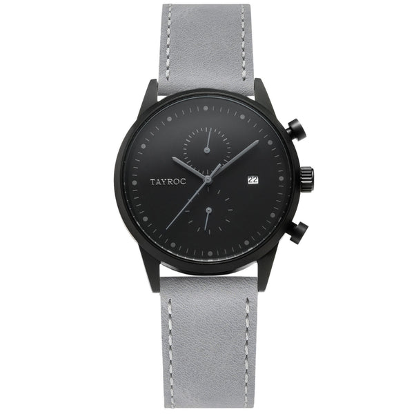 TXM122 is easy on the eye. The soft colour palette of grey and black make this timepiece a respectable accessory for any outfit. Front view.