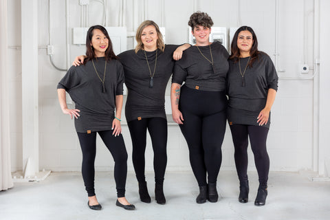 women wearing black leggings and dark grey tops