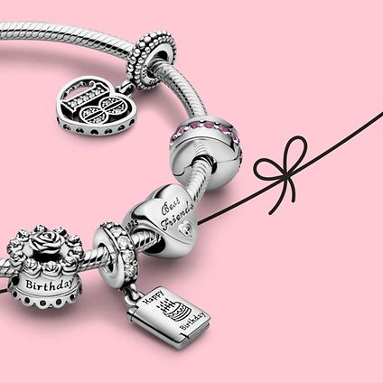 Close up of silver Pandora charm bracelet with birthday and best friends charms