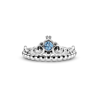 Pandora Disney Cinderella 70th Anniversary Blue Tiara Rings hand-finished in sterling silver. Shaped like a princess tiara, this openwork design includes a central blue stone surrounded by symmetrical swirls with a crown on top and heart beneath. A line of beads form the ring shank.