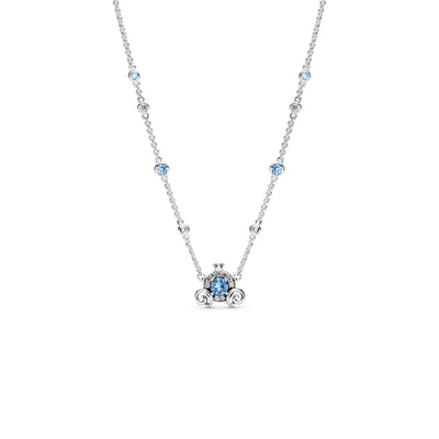 Pandora Disney Cinderella Pumpkin Coach Necklace in sterling silver, the pumpkin carriage-shaped design includes a central blue stone surrounded by clear cubic zirconia with a 3D crown on top and swirled leaf detailing for wheels. Larger stones are fixed along the adjustable chain that features Cinderella's slipper and a Pandora crown O monogram logo tag dangling from the clasp.