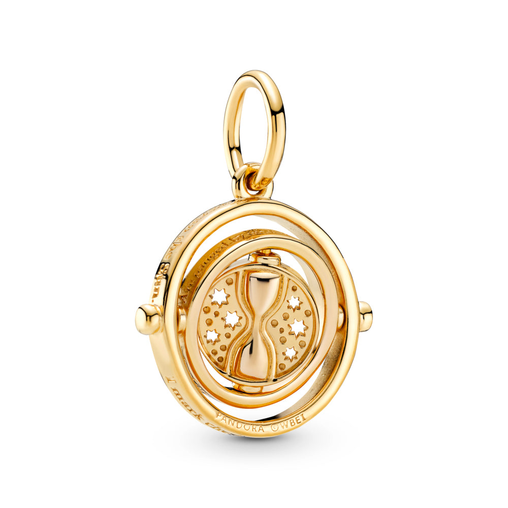 "Harry Potter Spinning Time Turner Pendant in Pandora Shine™ , 18k gold-plated metal. This design has spinning inner circles and a disc with a raised hourglass surrounded by cut-out stars. Engravings on the circles read: ""I mark the hours, every one, nor have I yet outrun the Sun""; ""My use and value, unto you, are gauged by what you have to do."" ."