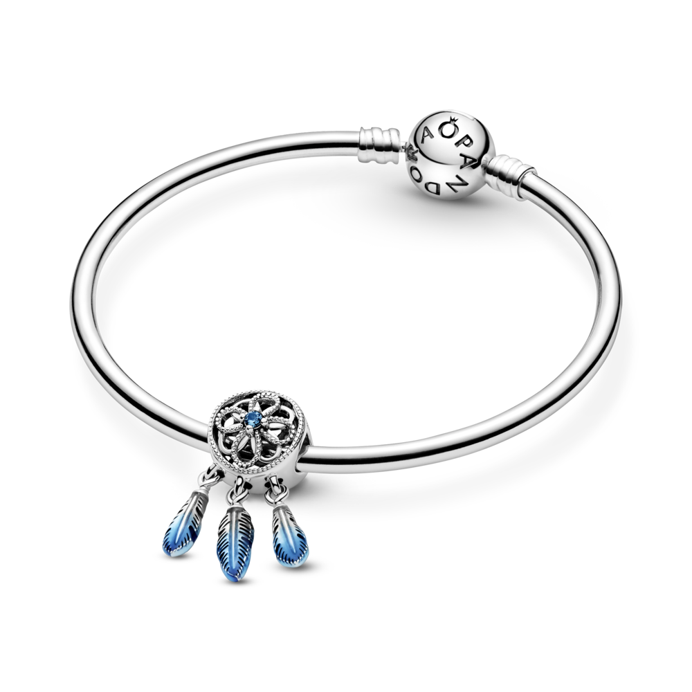 Pandora for Unicef Blue Dreamcatcher Charm in sterling silver with blue enamel feathers. Shown on sterling silver moments bangle bracelet. style #799341C01