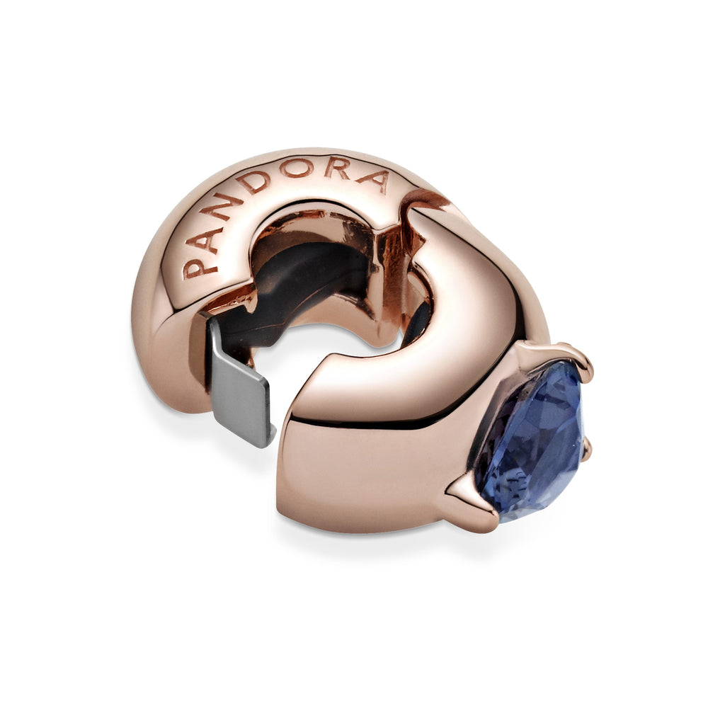 Close up of Pandora Rose Blue Heart Solitaire Clip Charm with silicone grip inside.