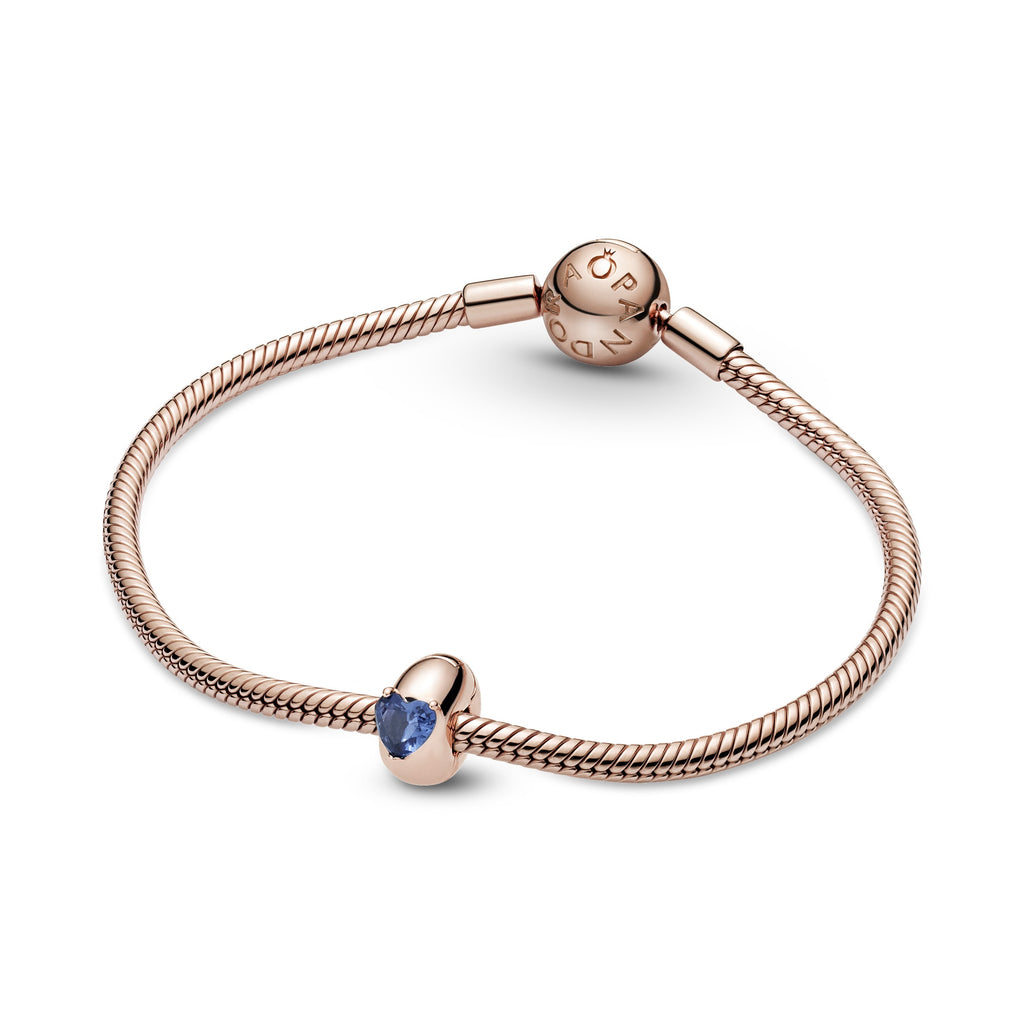Pandora Rose Blue Heart Solitaire Clip Charm with silicone grip inside shown on Pandora Rose Moments Bracelet