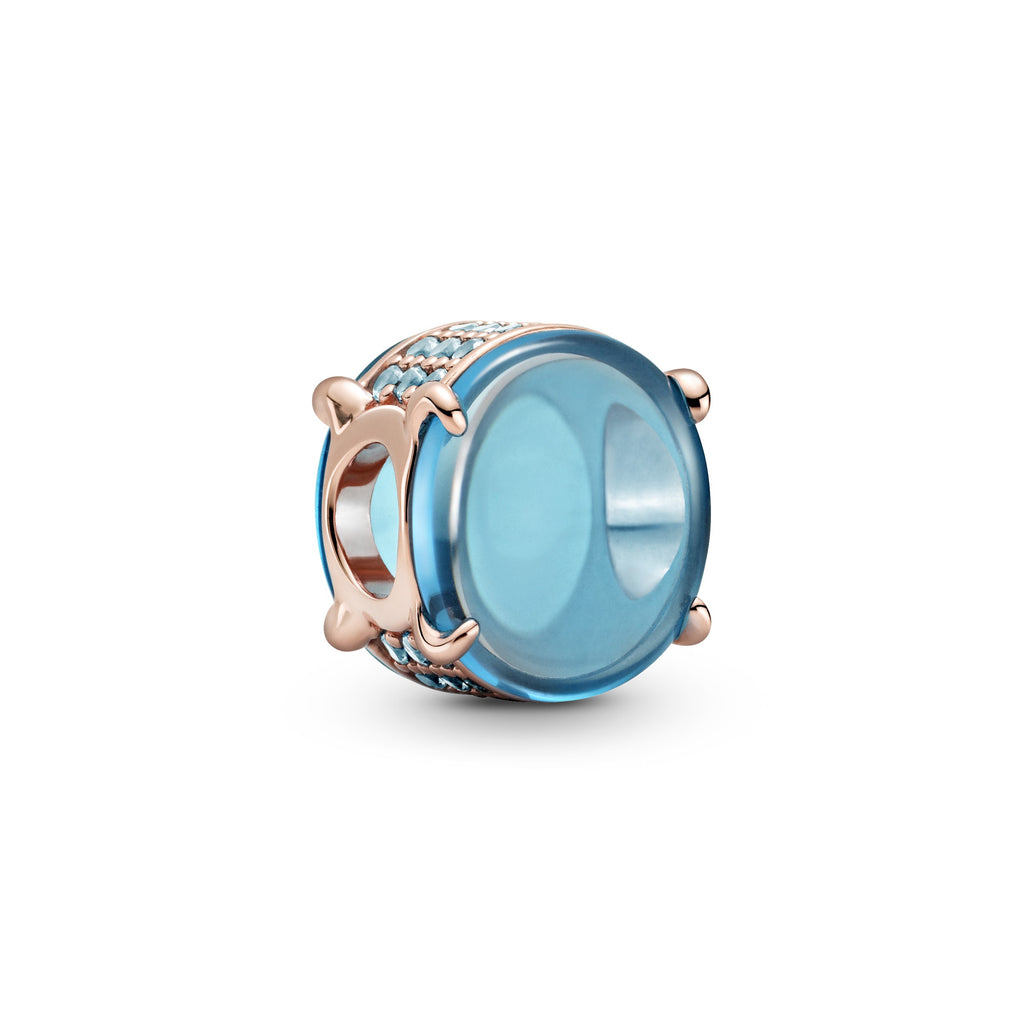 Pandora Rose™ Blue Oval Cabochon Charm. The charm has two oval cabochon-cut stones and the edges are lined with blue stones for added sparkle.