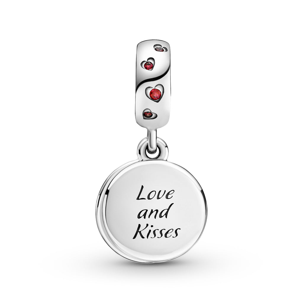 "Pandora Disney Mickey Mouse & Minnie Mouse Love and Kisses Dangle Charm in sterling silver. The open front disc includes Minnie Mouse's silhouette. The back disc features Mickey Mouse in front of the shaded red and magenta transparent enamel with hearts. The backside of the disc is engraved ""Love and Kisses,"" and red stones in heart-shaped settings decorate the bail."