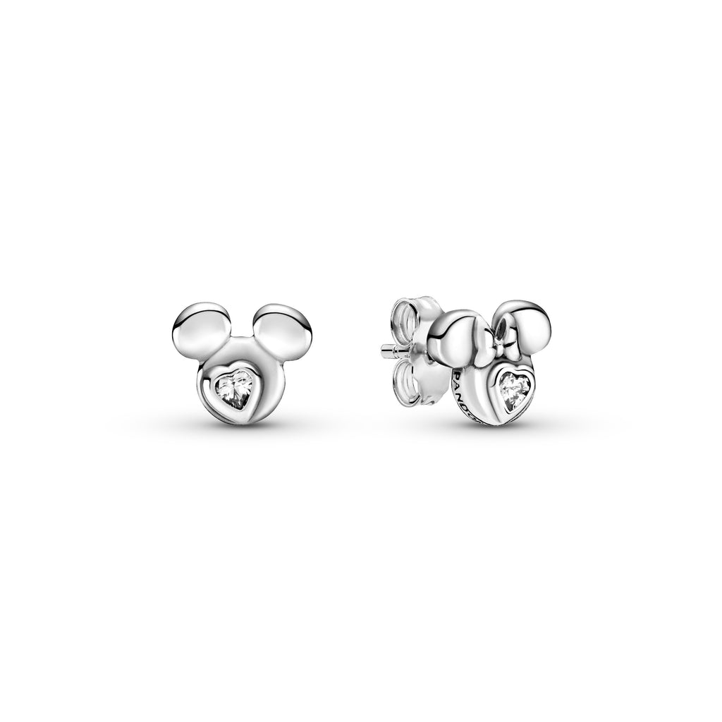 Pandora Disney Mickey Mouse & Minnie Mouse Silhouette Stud Earrings in sterling silver. The mismatched set of studs has one depicting Mickey Mouse's profile and the other Minnie Mouse. Both have a clear heart-shaped stone at its center.