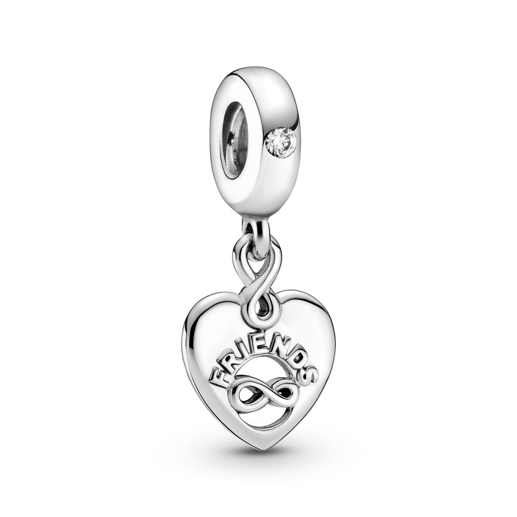 "Friends Forever Heart Dangle Charm in sterling silver, this heart-shaped dangle includes an asymmetric infinity sign cut-out with ""Friends"" in raised lettering on the front and the engraving ""Forever"" on the back. Another infinity sign connects the dangle with the bail, which features a sparkling clear stone."