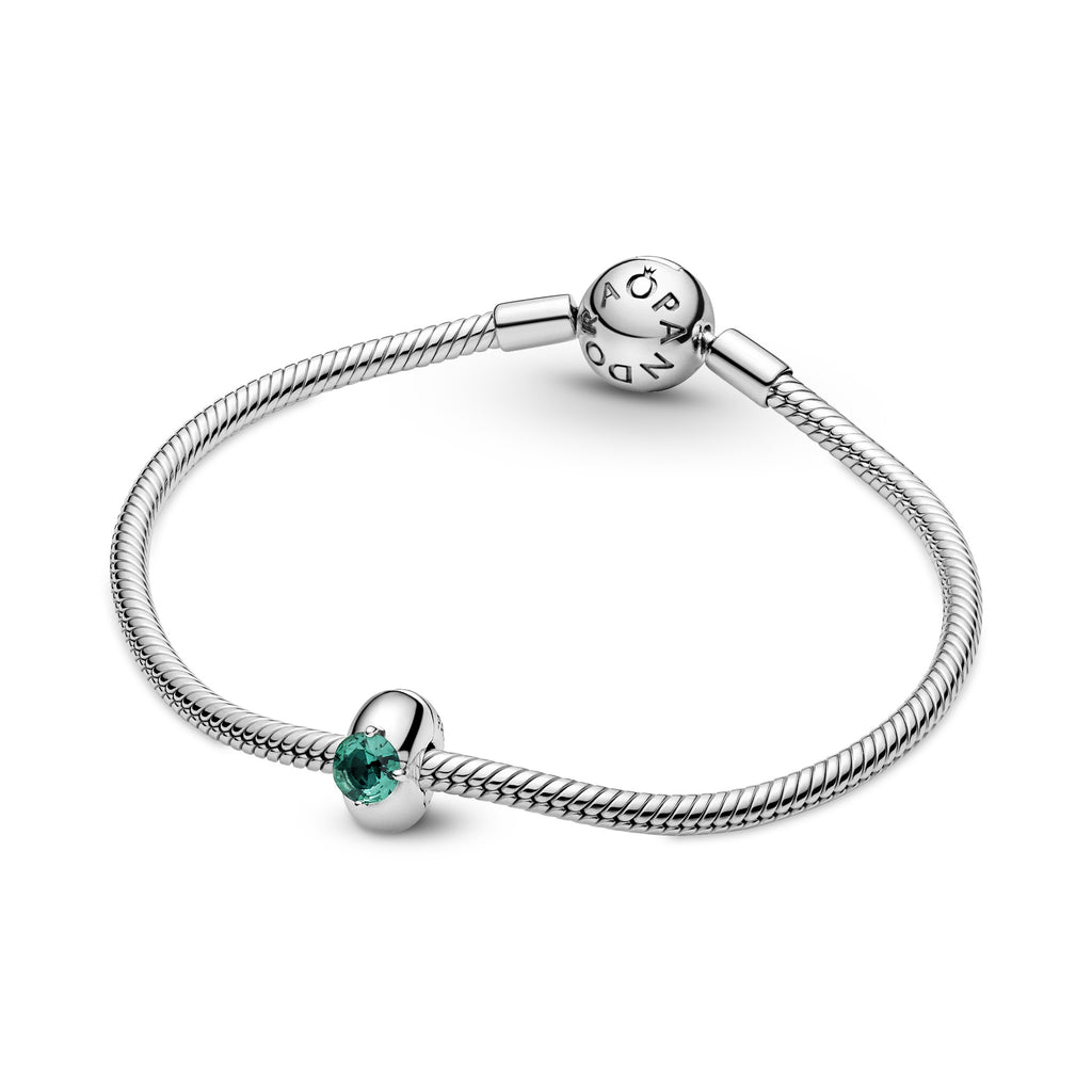 Pandora Green Round Solitaire Clip Charm in sterling silver with an interior silicone grip shown featured on a sterling silver bracelet.