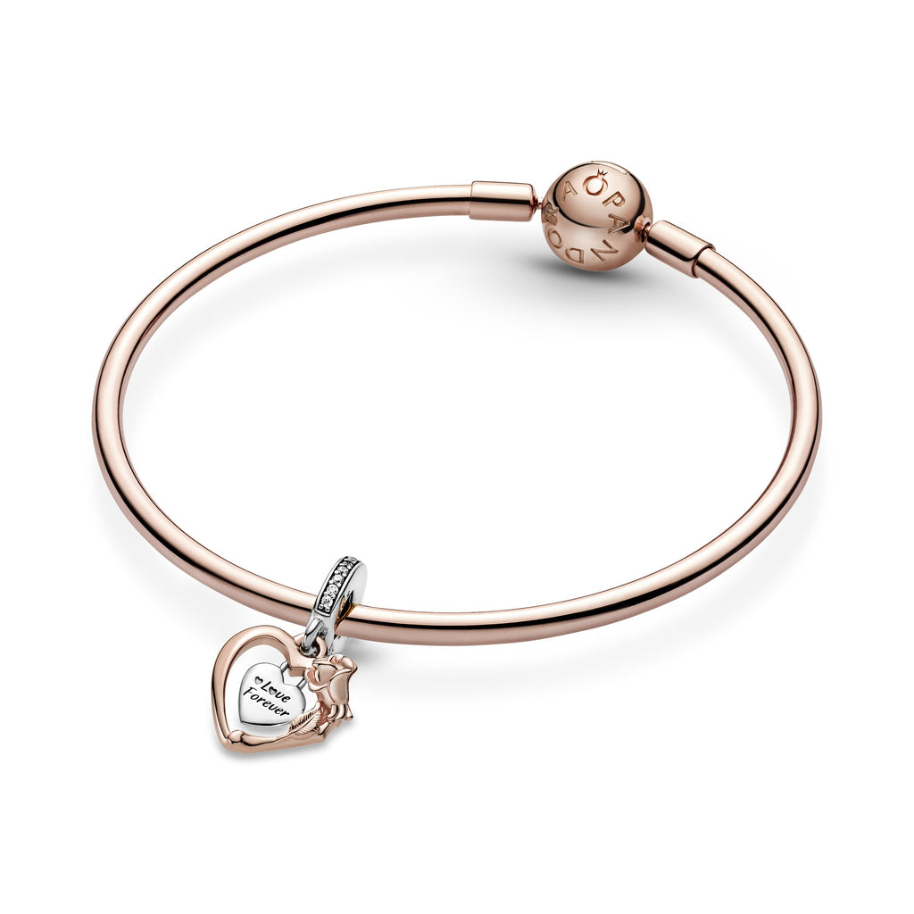 "Pandora Heart & Rose Flower Dangle Charm in sterling silver and Pandora Rose featured on Pandora Rose bangle. The charm has a heart-shaped frame with a padlock heart dangling within it engraved ""Love Forever"". The frame has intricate rose petal and leaf details."