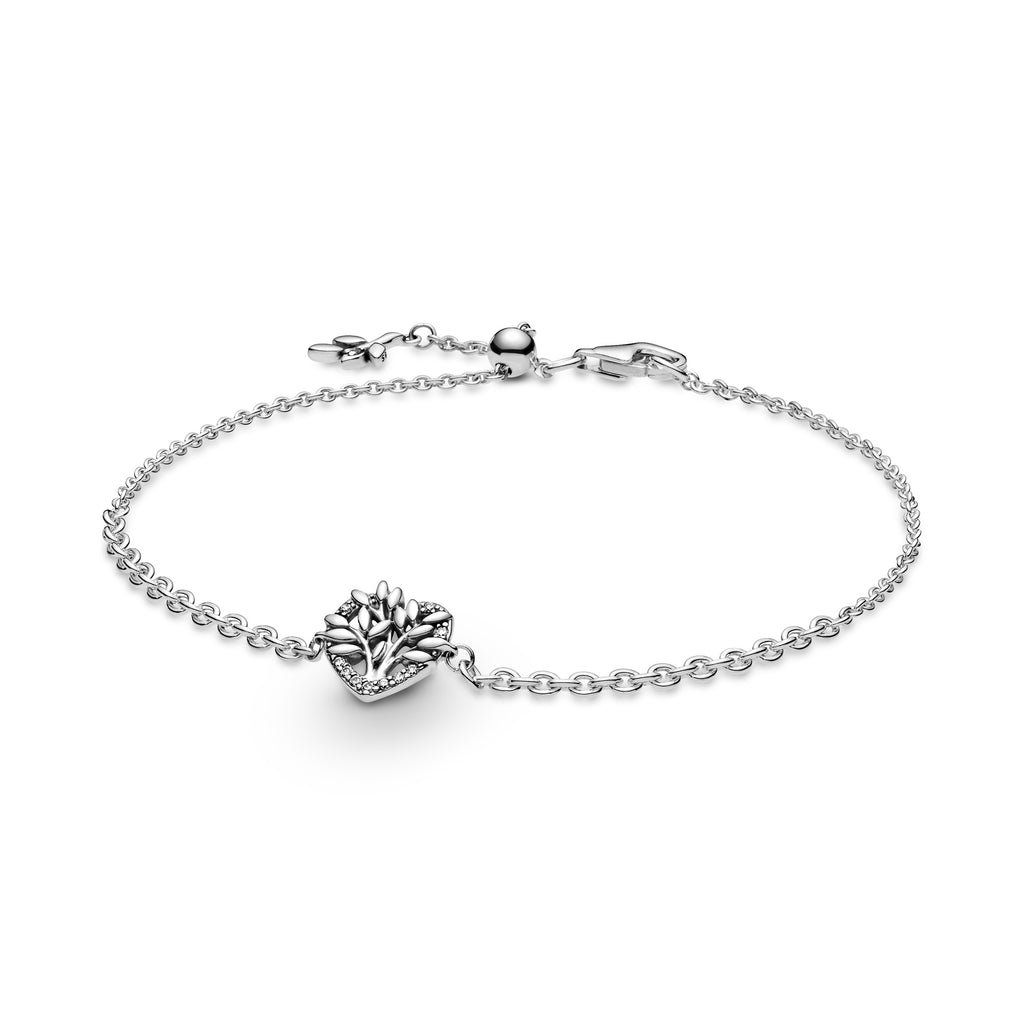 Pandora Heart Family Tree Chain Bracelet in sterling silver. The family tree motif sits on top of a heart shaped disc with clear sparkling stones and polished leaf details. Two different-sized chains are fused together with a slider clasp and a sparkling leaf branch detail attached to the end of the chain.
