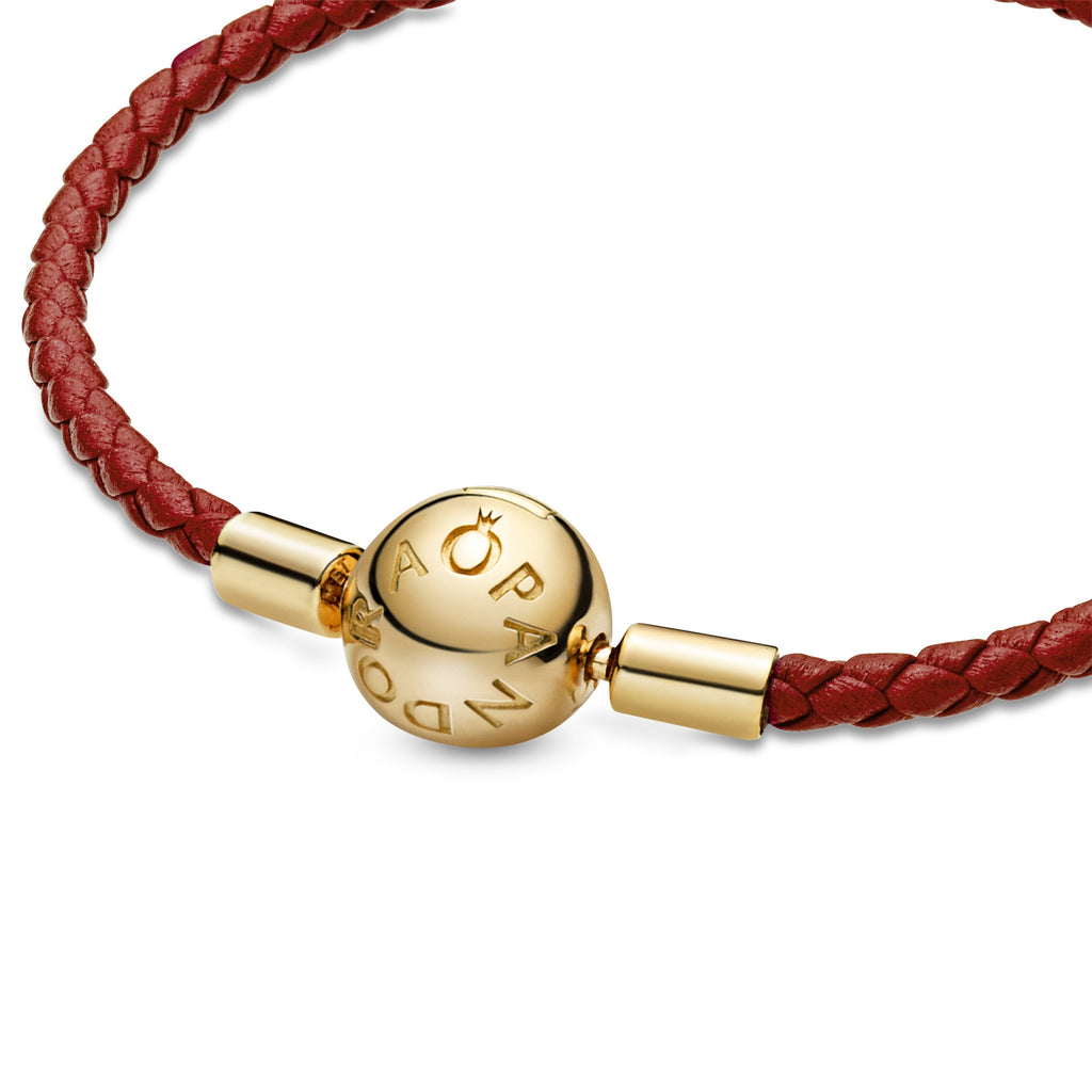Pandora Moments Red Woven Leather Bracelet with clasp detail in Pandora Shine, an 18k gold-plated unique metal blend.