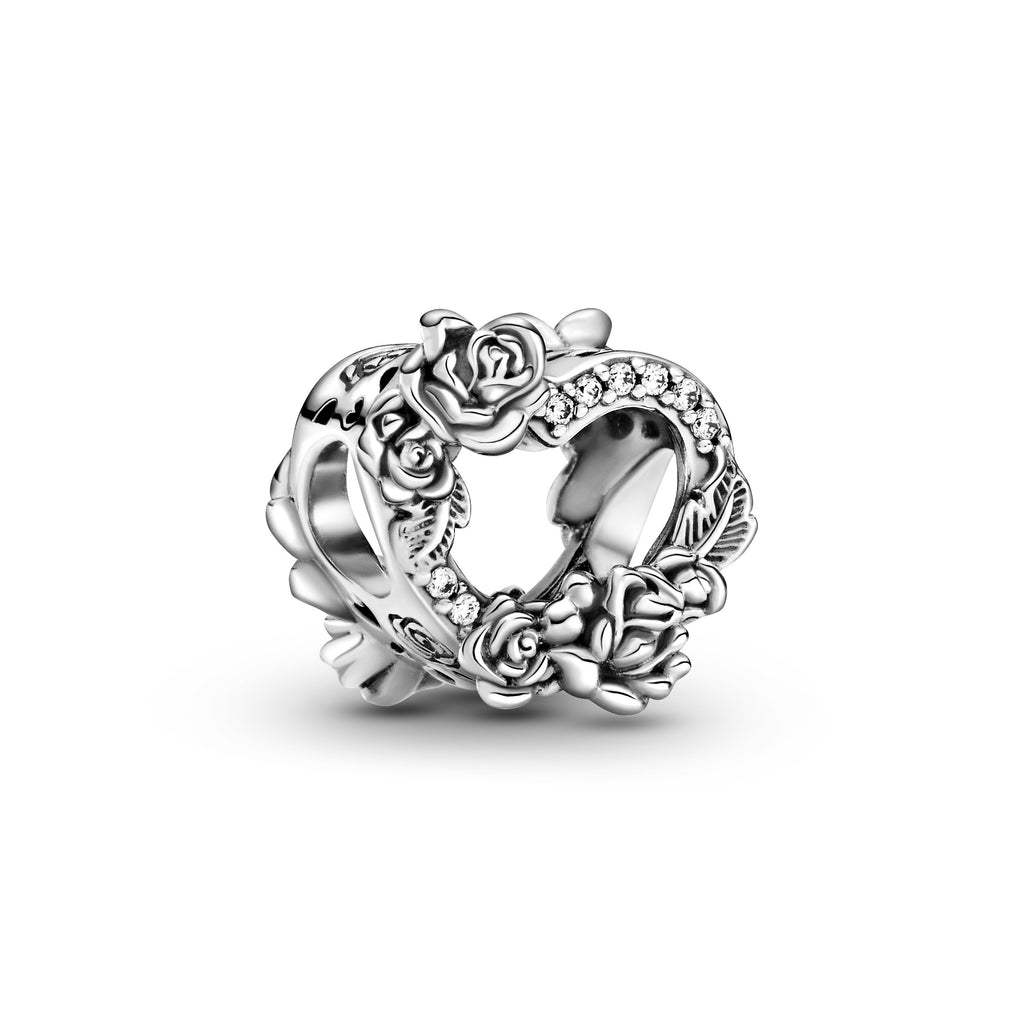 Pandora Open Heart & Rose Flowers Charm in sterling silver. This open-heart charm is intricately detailed with decorative rose flowers, leaf shapes and clear sparkling stones. The sides of the charm are engraved with rose flowers, petals, and heart cut-outs.