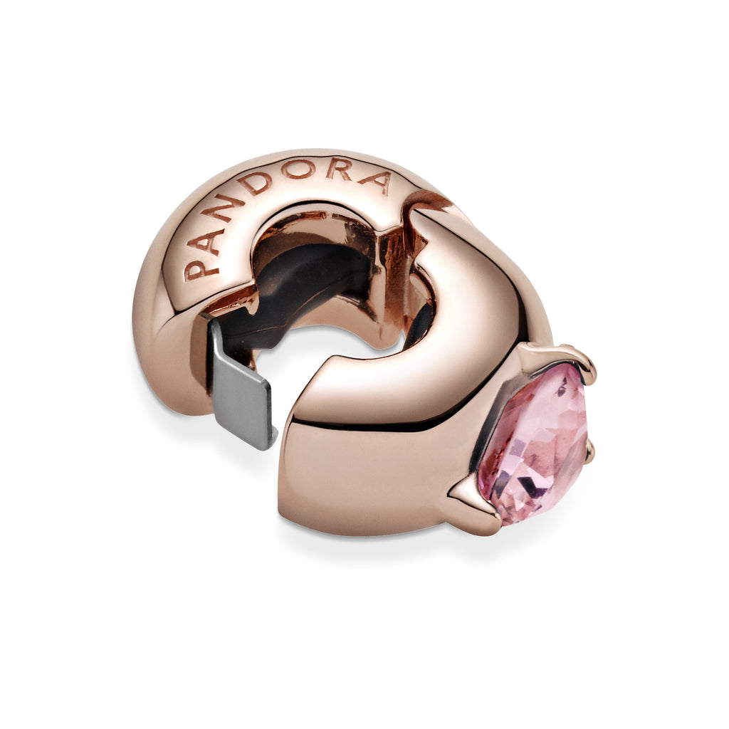 Pink Heart Solitaire Clip Charm in Pandora Rose™ (14k rose gold-plated unique metal blend). This charm is inspired by the look of solitaire rings with a raised heart-shaped stone crystal. This clip charm has a silicone grip inside.
