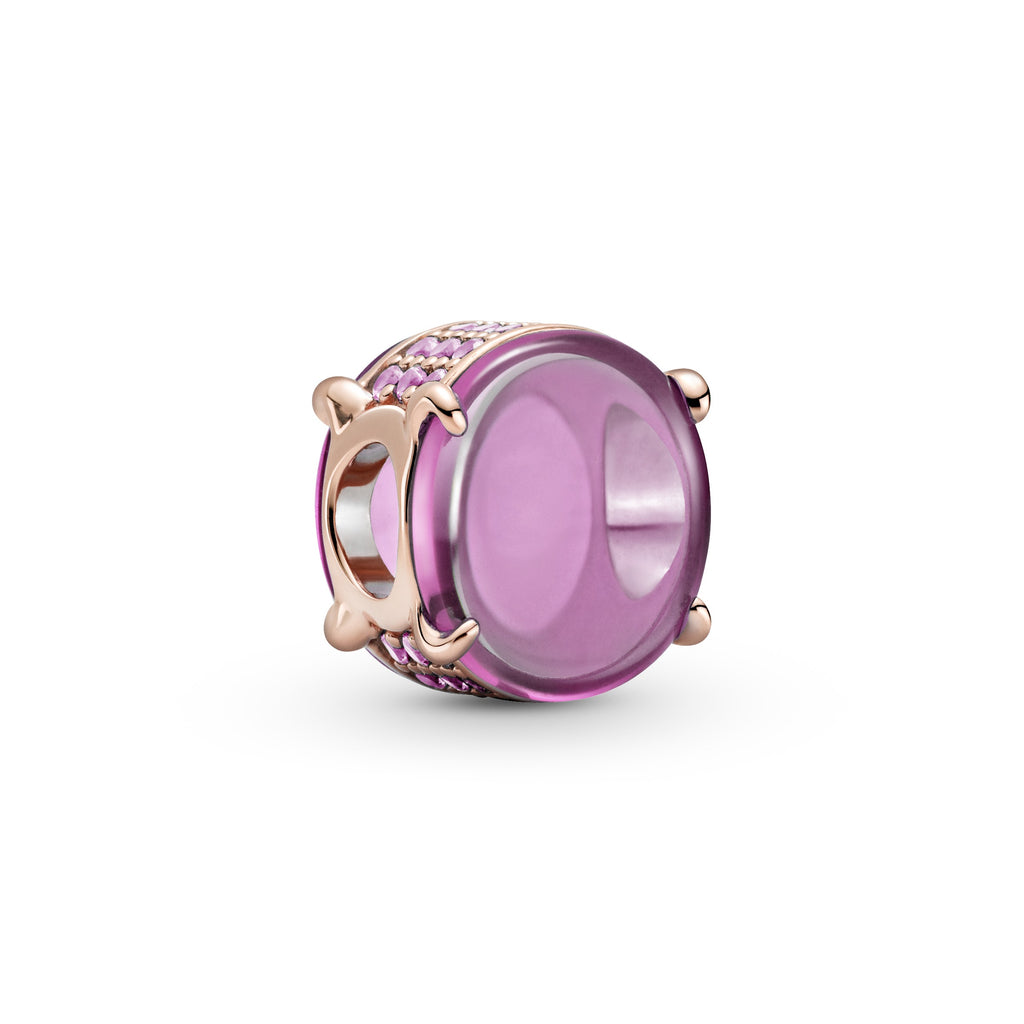 Pink Oval Cabochon Charm in Pandora Rose™ (14k rose gold-plated unique metal blend). This charm has two oval cabochon-cut stones to create a see-through button-shaped charm. The edges are lined with sparkling pink stones.