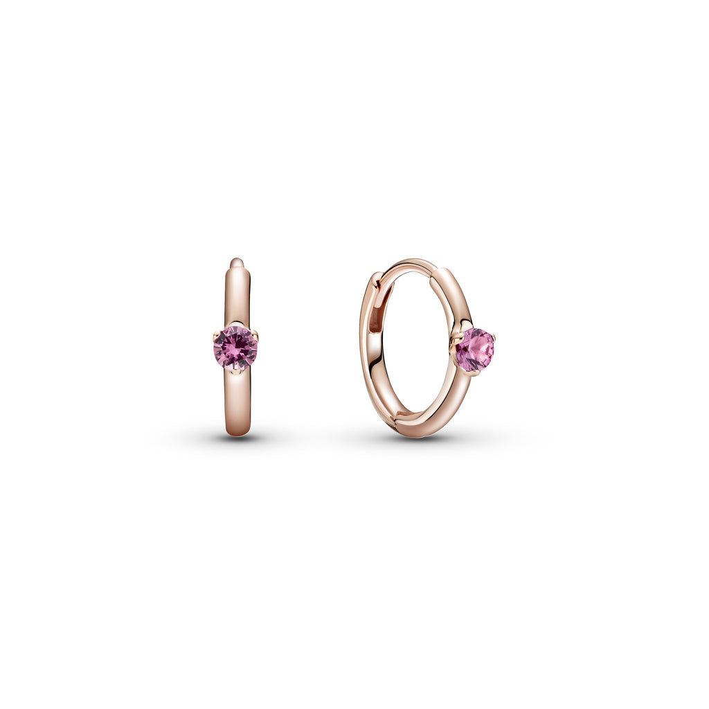 Pandora Pink Solitaire Huggie Hoop Earrings. Hand-finished in Pandora Rose™ (14k rose gold-plated unique metal blend), each hoop features a pink stone.