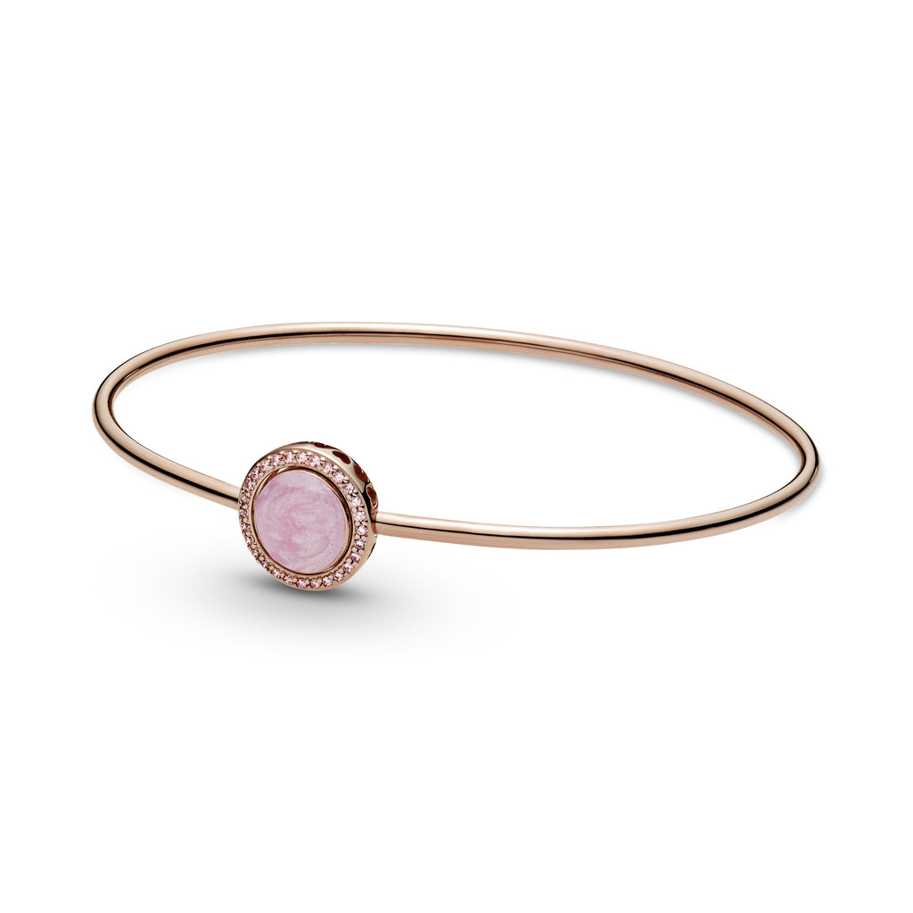 Pandora Pink Swirl Bangle in Pandora Rose™. The thin bangle bracelets centerpiece has hand-applied pearlescent pink swirl enamel made to mimic rose quartz surrounded by pink sparkling stones.