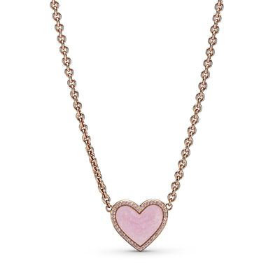 Pandora Pink Swirl Heart Collier Necklace in Pandora Rose™. The heart-shaped centerpiece has hand-applied pearlescent pink swirl enamel made to mimic rose quartz. The chain is adjustable to two different lengths with a sparkling pink heart-shaped tag at the end of the chain