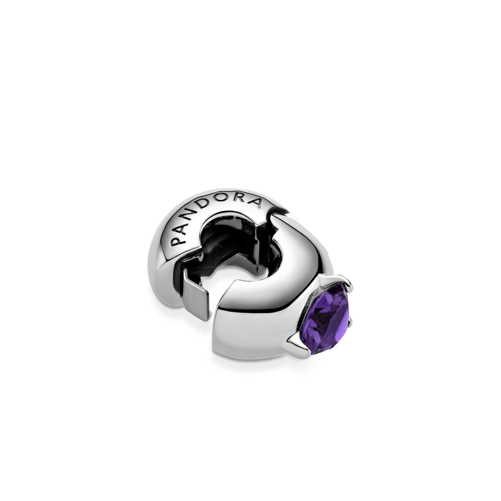 Pandora Purple Round Solitaire Clip Charm shown open with silicone grip inside