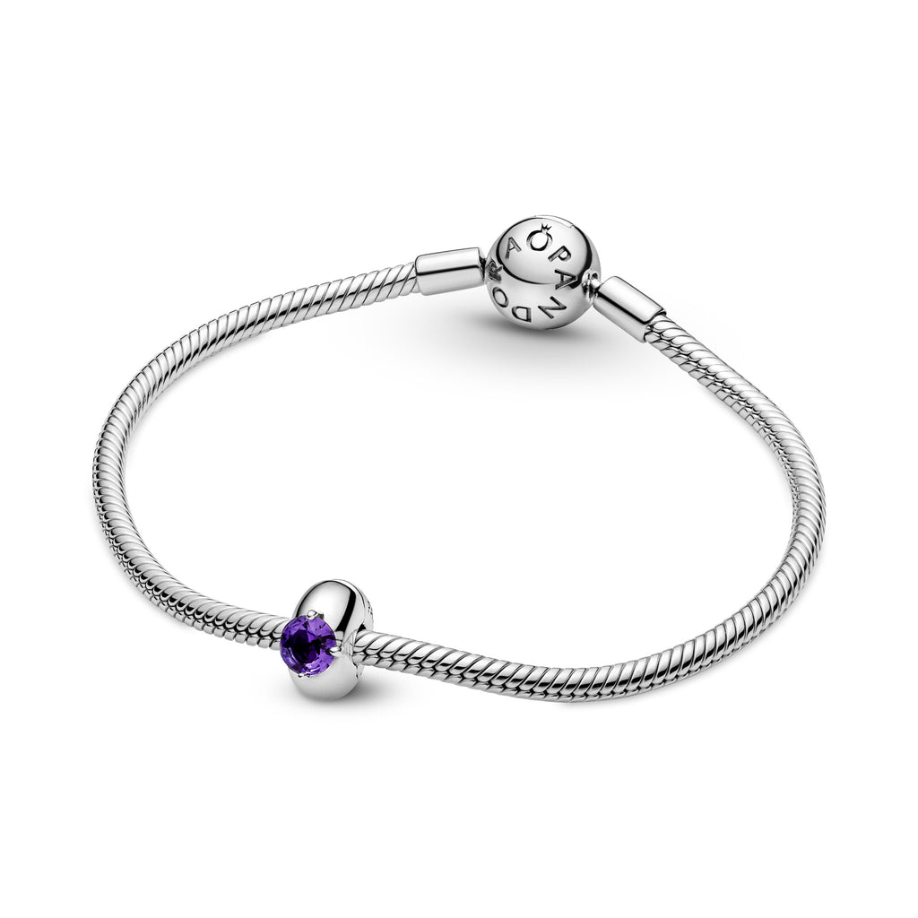 Pandora Purple Round Solitaire Clip Charm featured on sterling silver bangle.