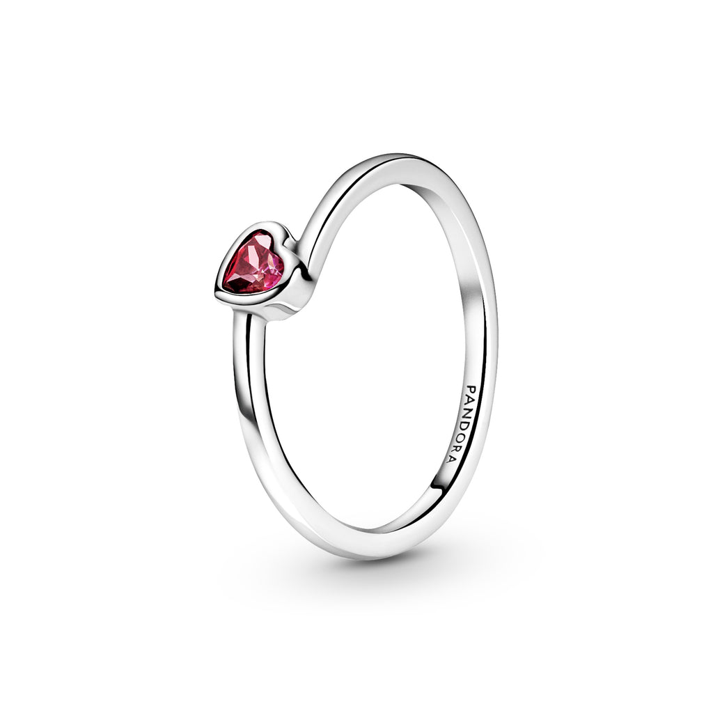 Pandora Red Tilted Heart Solitaire Ring in sterling silver. Featuring a thin polished band, the ring includes a titled red heart-shaped stone.