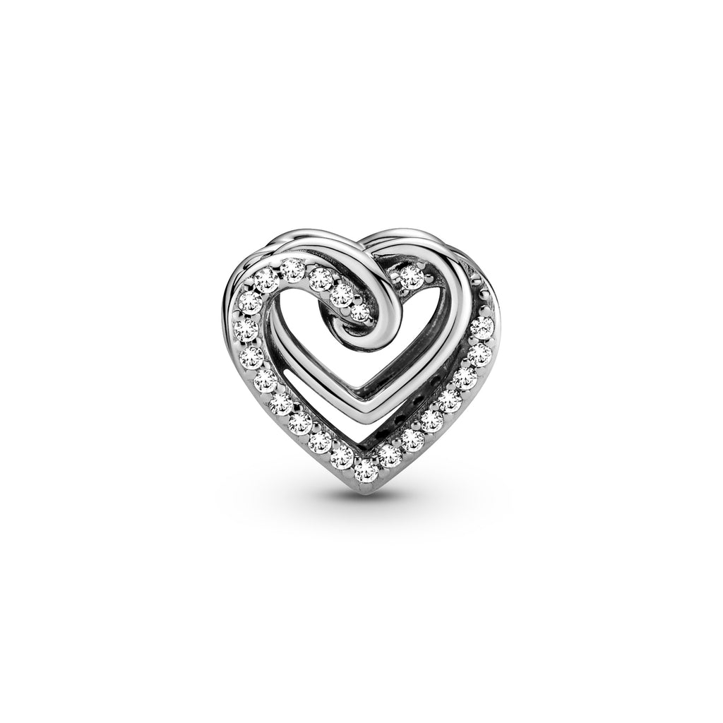 Pandora Sparkling Entwined Hearts Charm. The heart shaped charm has intertwining polished sterling silver hearts and sparkling stone-embellished hearts on the front and back. Entwined hearts are also featured on the sides.