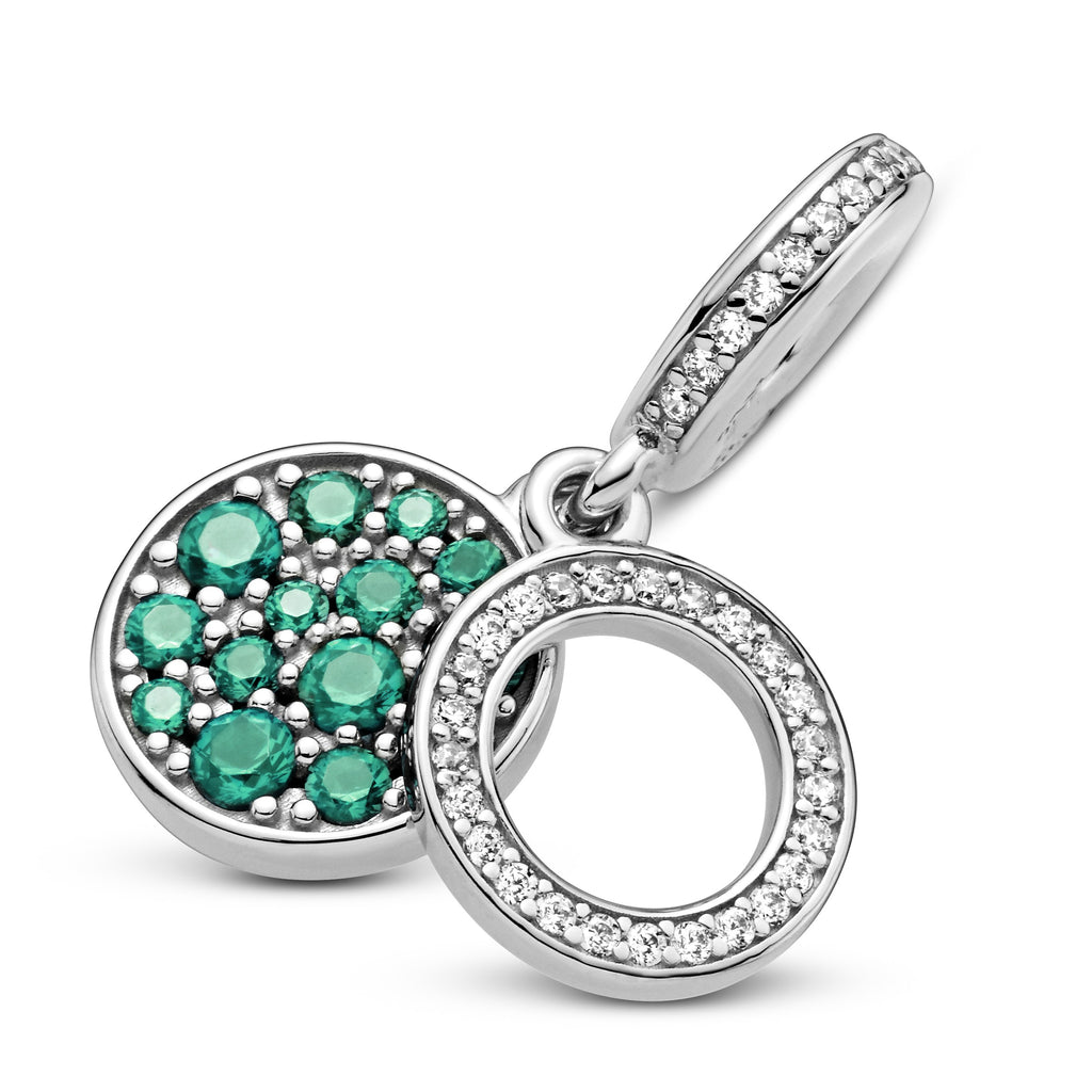 Pandora Sparkling Green Disc Double Dangle Charm in sterling silver. The back disc has beading with green stones in various sizes. The Pandora logo and crown O monogram are on the back. The front open circle disc has clear cubic zirconia.