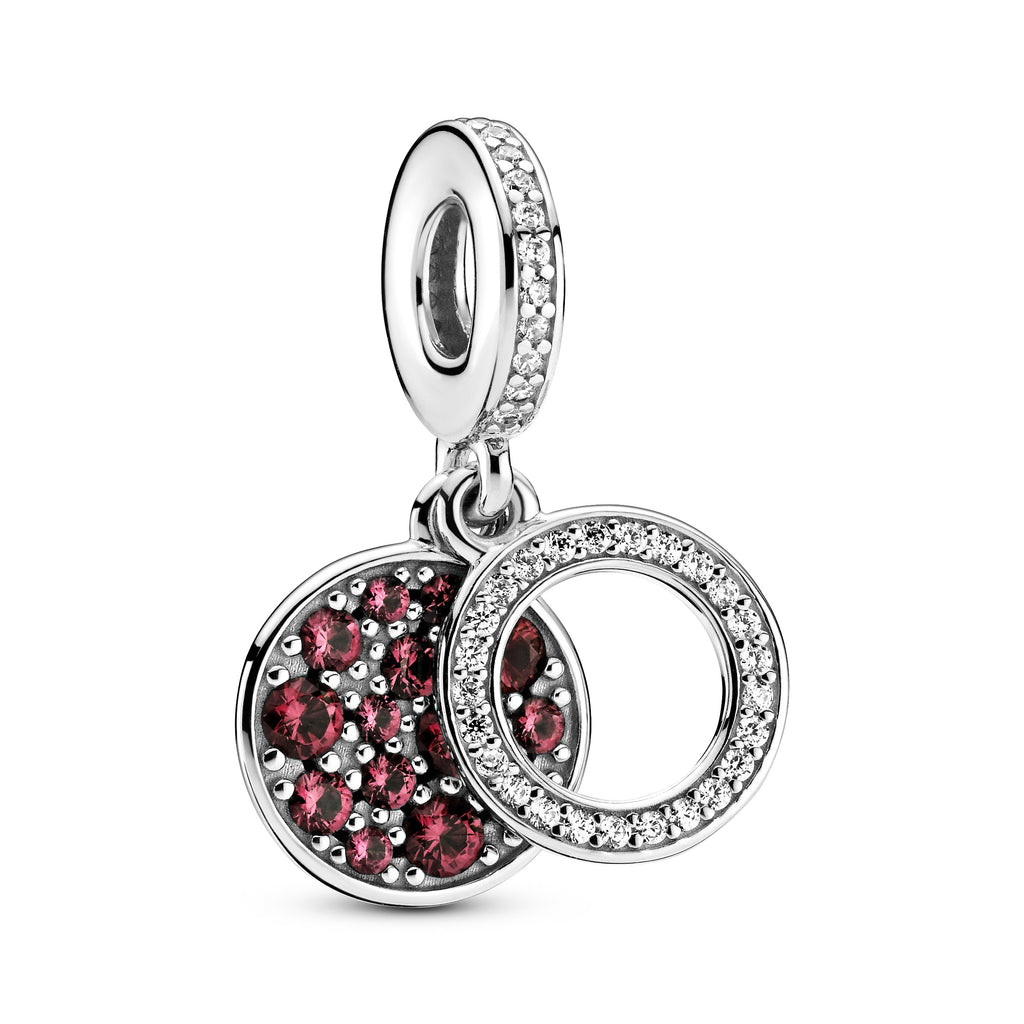 Pandora Sparkling Red Disc Double Dangle Charm in sterling silver. The back disc has beading with red stones in various sizes. The Pandora logo and crown O monogram are on the disc's reverse side. The front open circle includes clear cubic zirconia.