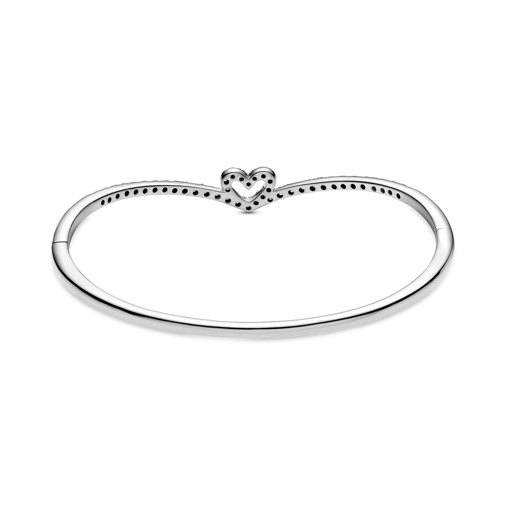 Backside of Pandora Sparkling Wishbone Heart Bangle in sterling silver. The sparkling heart has the Iconic V-shape from the wish collection holding the heart. This openable style features a button for easy on and off.