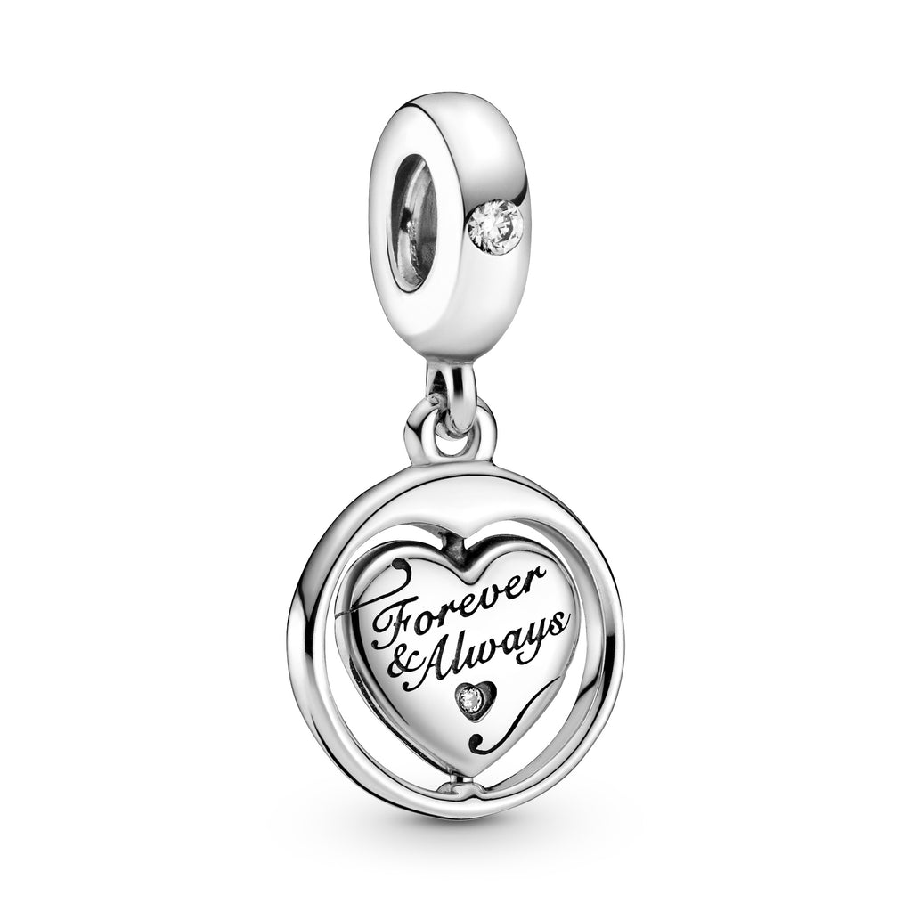 "Pandora Spinning Forever & Always Soulmate Dangle Charm. This sterling silver dangling design has a spinning heart surrounded by a round frame. The heart features the engravings ""Forever & Always"" and ""Soulmate,"" with a sparkling stone inside a cut-out heart on the front and a cut-out star detail on the back. This is showcasing the Forever & Always  side of the heart."