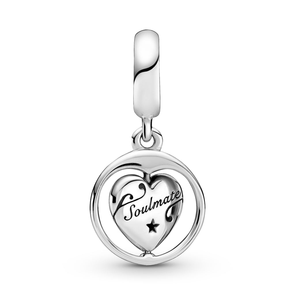 "Pandora Spinning Forever & Always Soulmate Dangle Charm. This sterling silver dangling design has a spinning heart surrounded by a round frame. The heart features the engravings ""Forever & Always"" and ""Soulmate,"" with a sparkling stone inside a cut-out heart on the front and a cut-out star detail on the back. This is showcasing the Soulmate side of the heart."