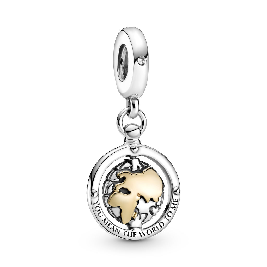 "Pandora Spinning World Dangle Charm. A sterling silver frame is engraved ""You mean the world to me"" with small, lifted hearts and a sparkling stone at the top. A flat spinning globe fits inside with longitude and latitude lines and the globe's continents are 14k gold. View of Africa, Asia and Europe."