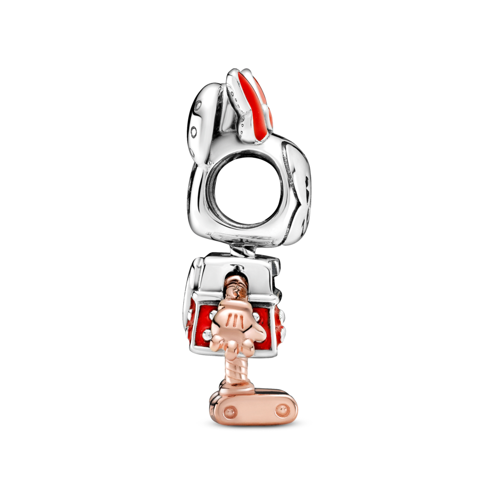 Profile view of disney x pandora minnie mouse charm in sterling silver, red enamel details, and pandora rose.  Her gloved hands are detailed as well as her robot like feet.
