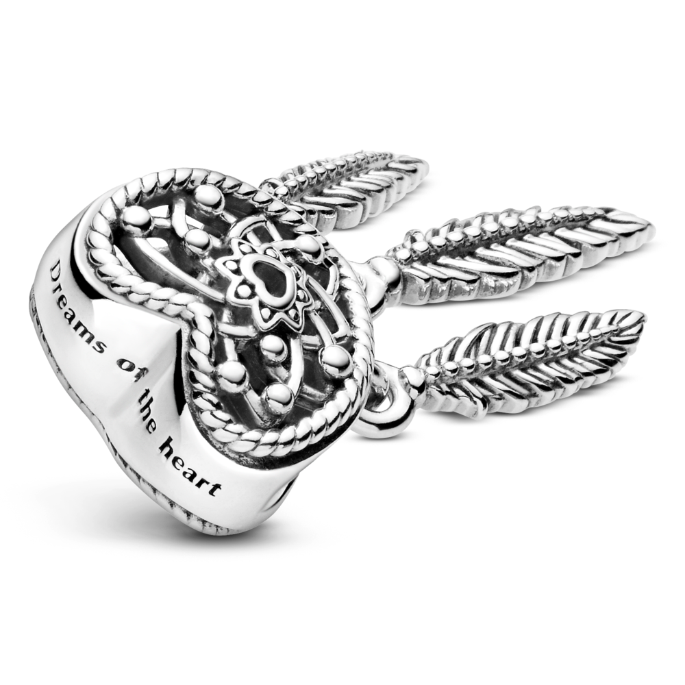 "Top view of Pandora Openwork Heart & 3 Feathers dreamcatcher dangle charm in sterling silver. ""Dreams of the heart"" is engraved on the top of the heart."