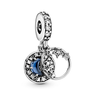 Pandora Blue Night Sky Crescent Moon and Stars Dangle Charm in sterling silver.  The front dangle features an open circle decorated with stars that overlap the frame. The back disc includes a raised blue half-moon-shaped stone surrounded by clear czs.