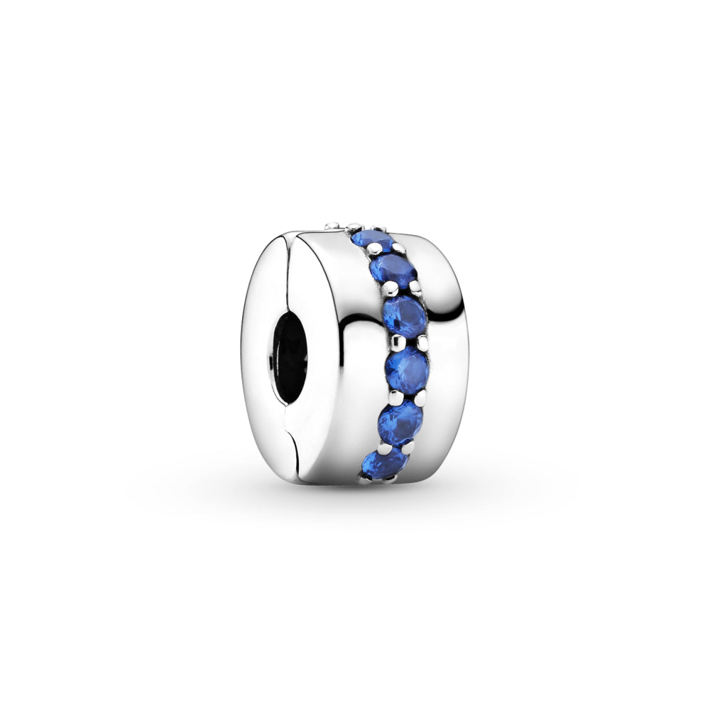 Pandora Blue Sparkle Shining Path Clip Charm. Hand-finished in sterling silver, this classic round design features a centered row of shimmering blue stones.