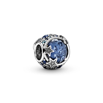 Pandora Celestial Blue Sparkling Stars Charm hand-finished in sterling silver. The rounded design includes a large blue stone in the center that's encircled by blue and clear stones in various sizes. Beaded stars overlap the central stone for added texture.