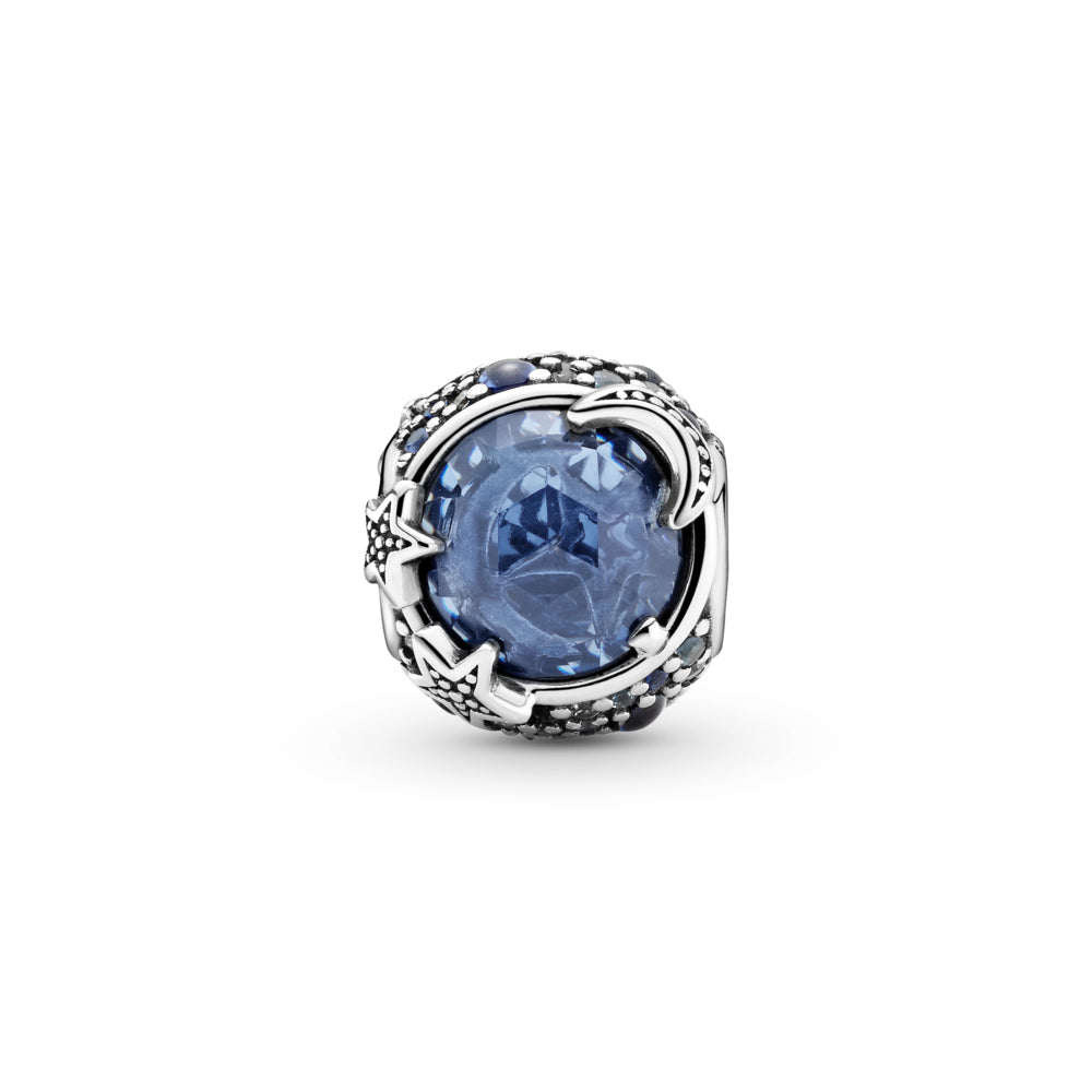 Back side of Pandora Celestial Blue Sparkling Stars Charm hand-finished in sterling silver. The rounded design includes a large blue stone in the center that's encircled by blue and clear stones in various sizes. Beaded stars overlap the central stone for added texture.