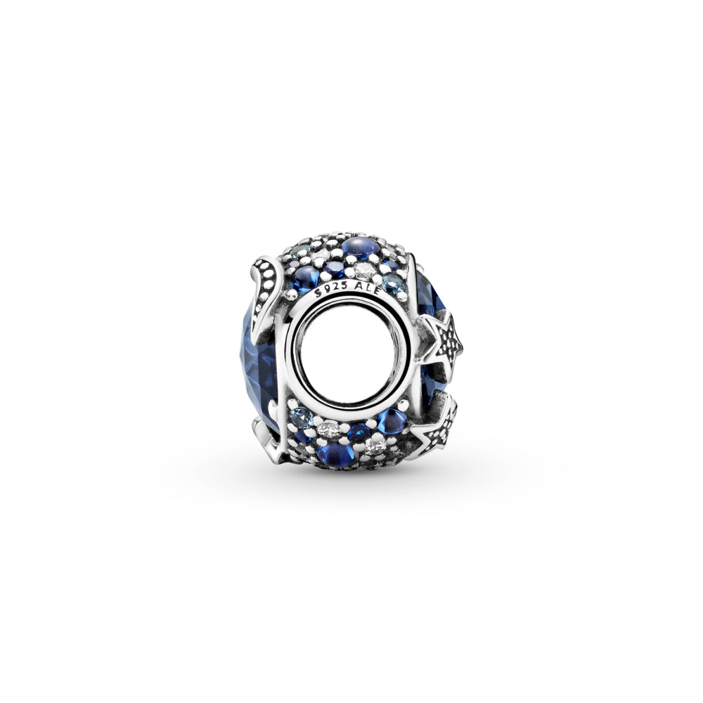 Profile view of Pandora Celestial Blue Sparkling Stars Charm hand-finished in sterling silver. The rounded design includes a large blue stone in the center that's encircled by blue and clear stones in various sizes. Beaded stars overlap the central stone for added texture.