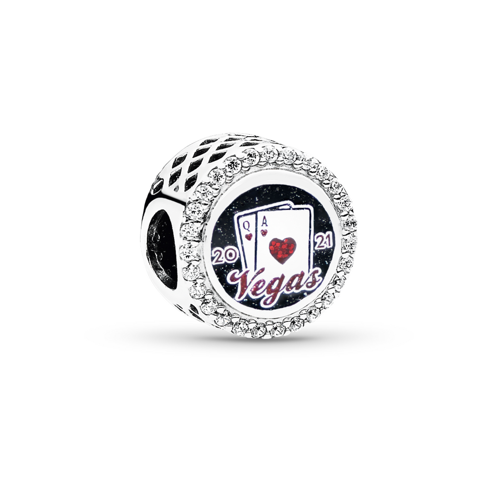 Pandora New Year's Limited Edition 'Cheers to 2021' Las Vegas Exclusive Charm. The front is engraved with a pair of playing cards hitting 21 & the inscription 'Vegas 2021' in black and red sparkling enamel.