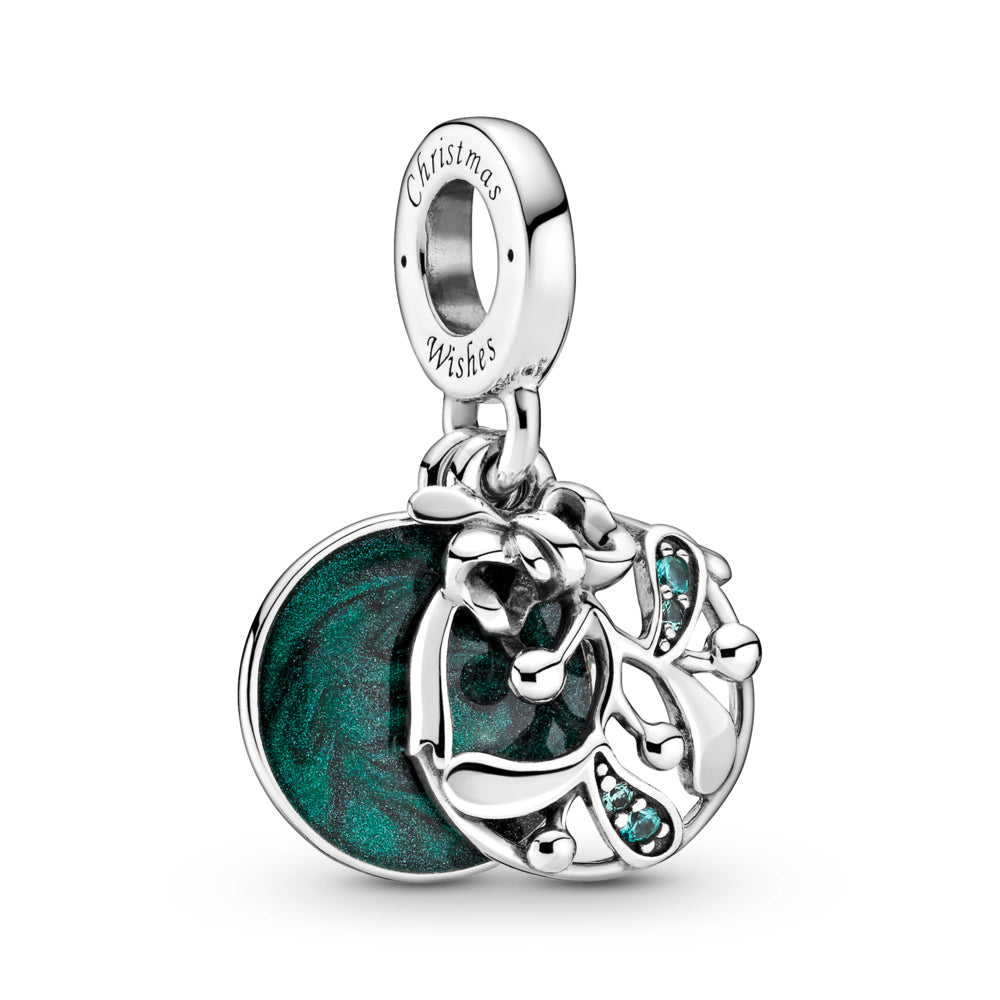 "Pandora Christmas Mistletoe Dangle Charm is hand-finished in sterling silver. A front openwork mistletoe dangle is decorated with green stones that hangs at an angle. The back disc features hand-applied shimmering green enamel and the engraving: ""Meet me under the mistletoe."" on the back of the disk. The engraving ""Christmas wishes"" is featured on the side of the bail."