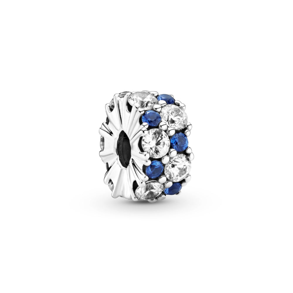 Pandora Clear & Blue Sparkling Clip Charm. Hand-finished in sterling silver,the round clip features clear and stellar blue stones in various sizes along its outer edge.