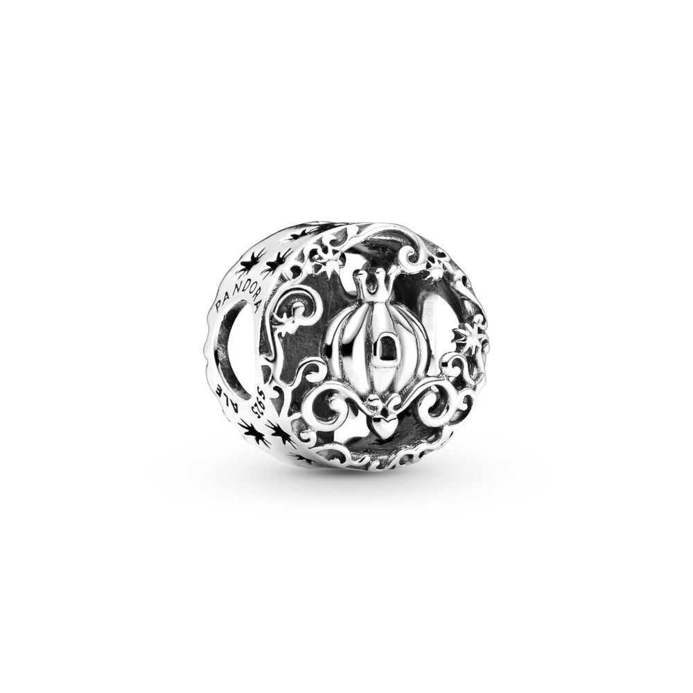 Pandora Disney Cinderella Midnight Pumpkin Charm in sterling silver. On one side, this openwork charm is decorated with a pumpkin carriage, a crown, small heart, swirling leaves and cut-out stars. The other includes the castle tower with its clock striking midnight and a mouse.