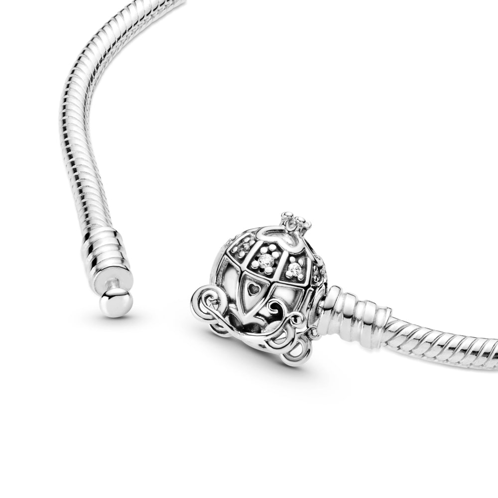 Close up of Disney Cinderella Pumpkin Coach Clasp Pandora Moments Bracelet is Hand-finished in sterling silver.  The clasp features a pumpkin carriage with stone settings for windows, four hearts that form a clover and a 3D crown on the roof, a grooved heart for a door handle and pumpkin wheels.