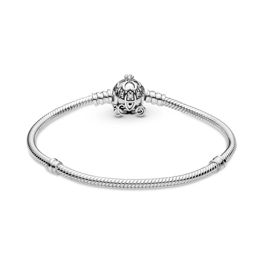Disney Cinderella Pumpkin Coach Clasp Pandora Moments Bracelet is Hand-finished in sterling silver.  The clasp features a pumpkin carriage with stone settings for windows, four hearts that form a clover and a 3D crown on the roof, a grooved heart for a door handle and pumpkin wheels.